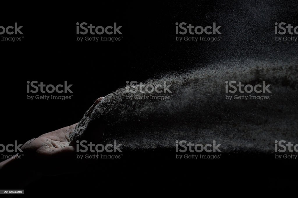 Hand throwing ashes stock photo
