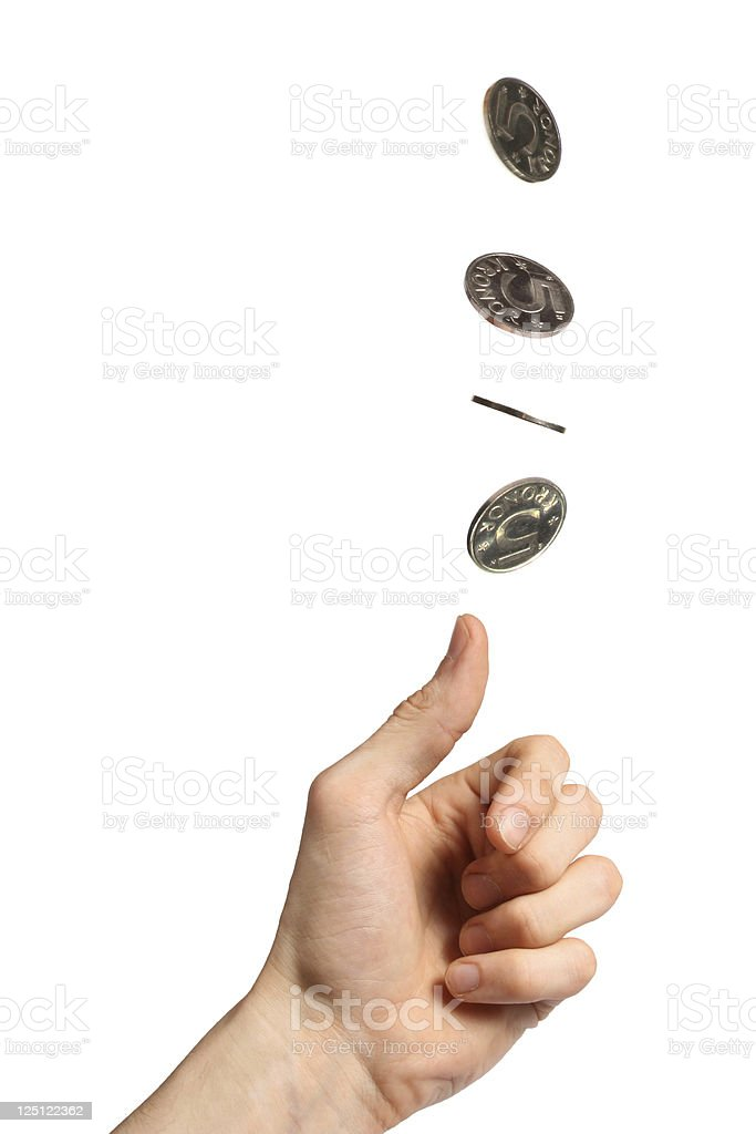 Hand throwing up several coins on white background stock photo
