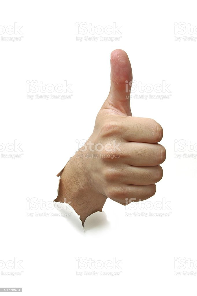 Hand thumbs up sign protruding through a white wall royalty-free stock photo