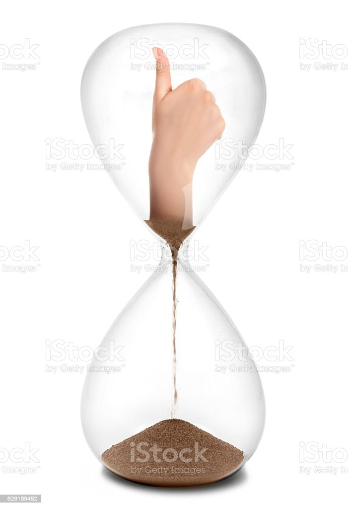Hand thump up sign is in the hourglass stock photo