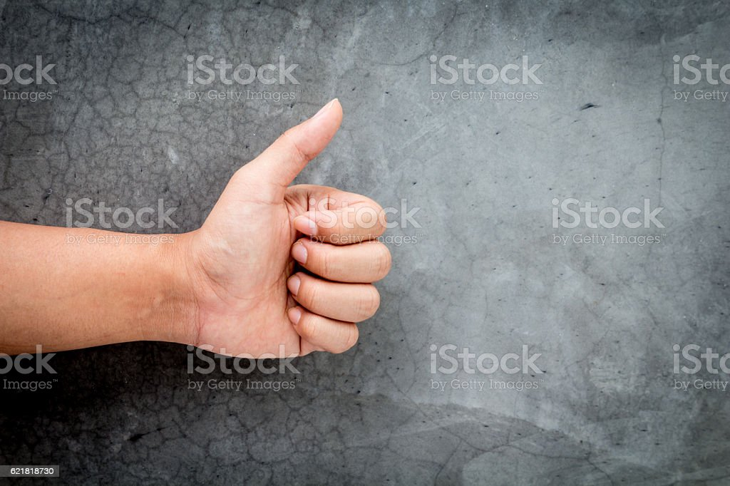 Hand thump up sign stock photo