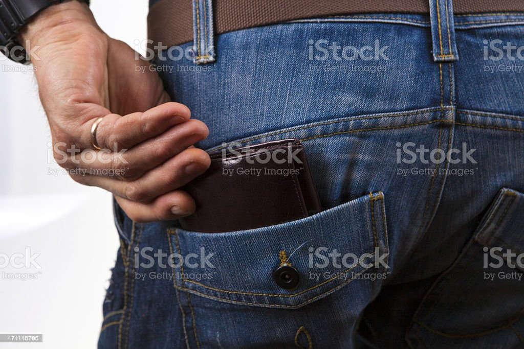 Hand to pull out the wallet stock photo