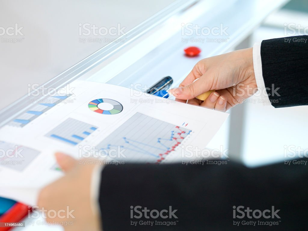 Hand to put the document and Whiteboard. royalty-free stock photo