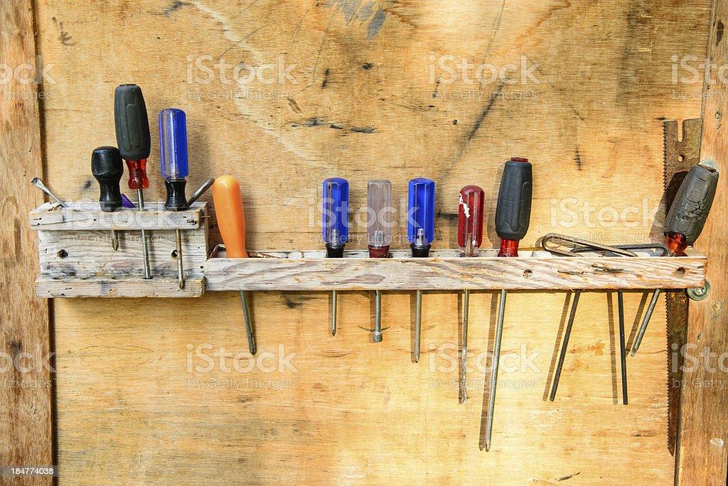 Hand tools hanging in homemade rack stock photo