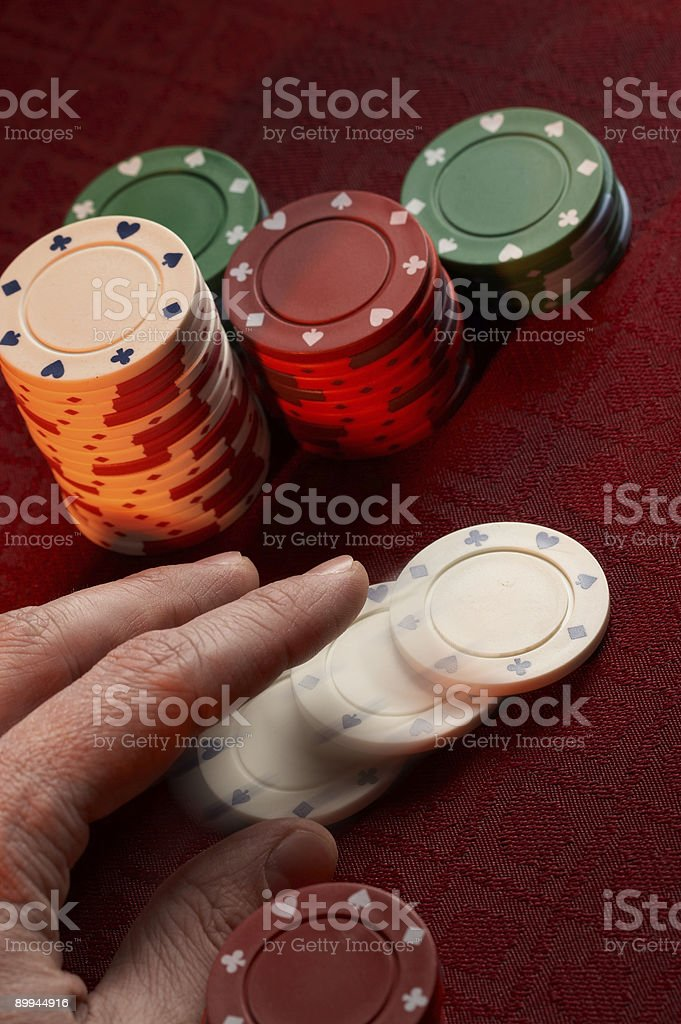 Hand tossing in chips stock photo