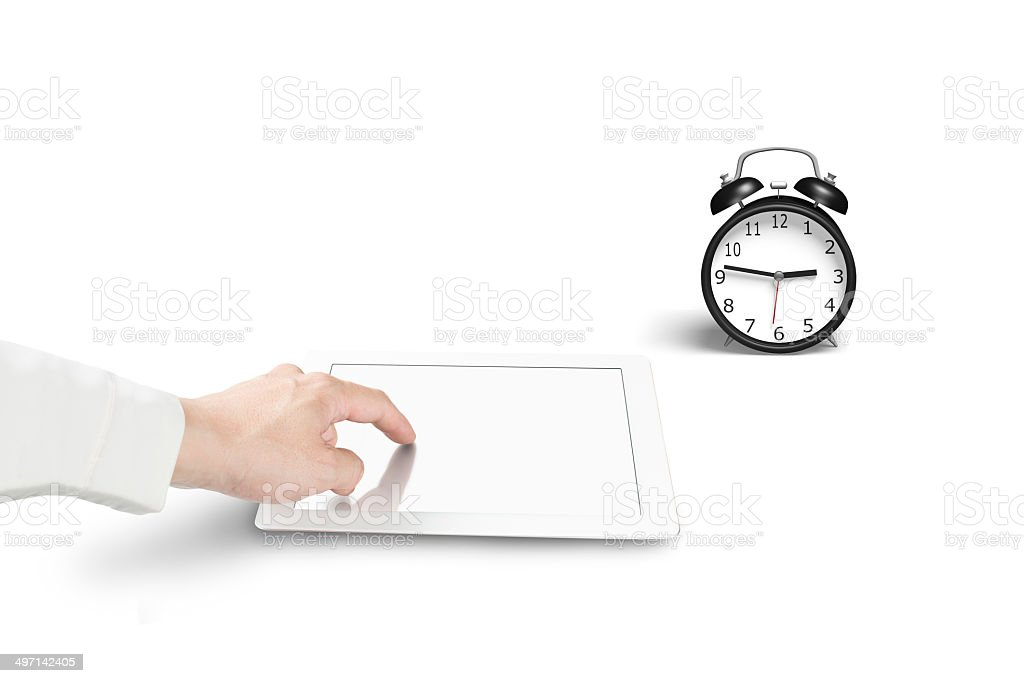 Hand touch blank tablet with alarm clock royalty-free stock photo