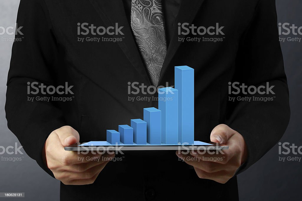 hand touch screen graph on a tablet royalty-free stock photo