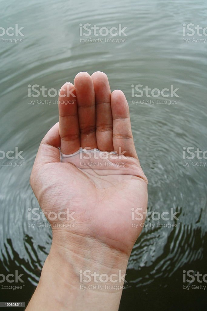 hand touch water royalty-free stock photo