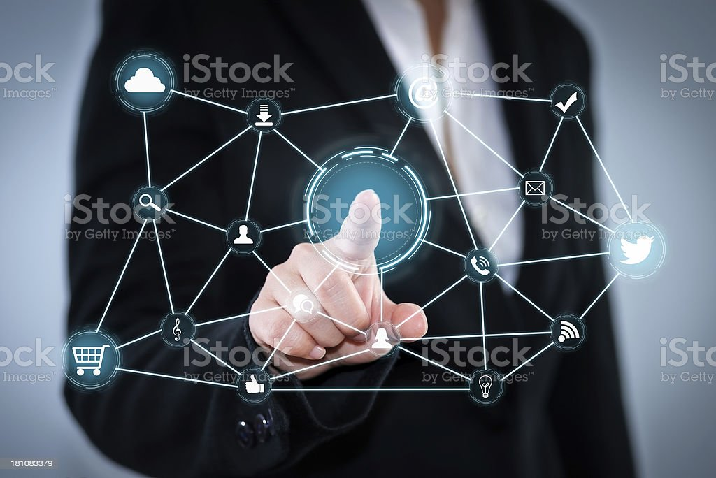 A hand touching a screen with social network icons stock photo
