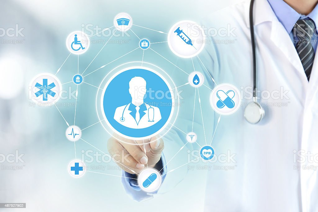 Hand touching doctor icon on virtual screen stock photo