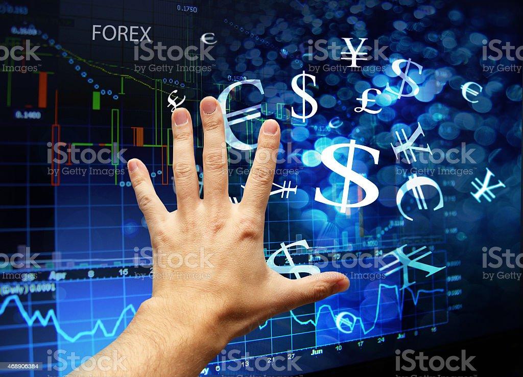 hand touching forex interface stock photo