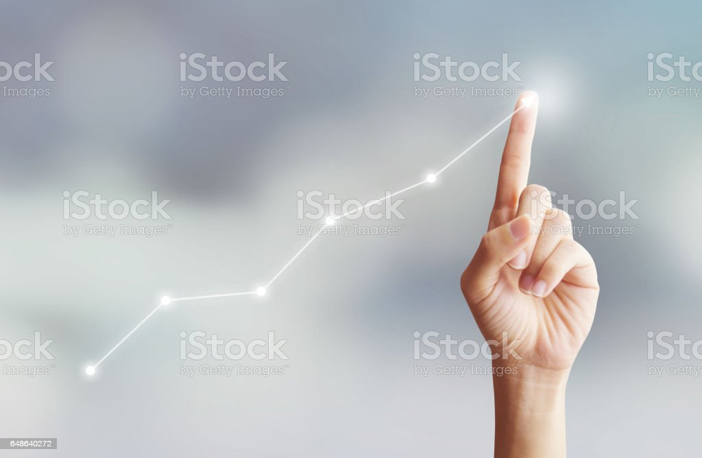 Hand touching graph moving up with plan growing stock photo