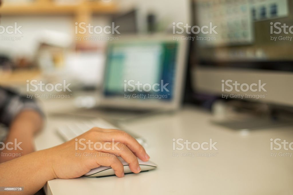 hand touching mouse on office desk stock photo