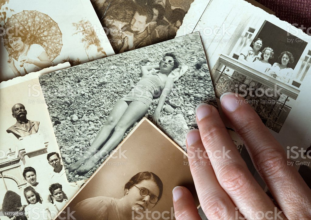 Hand touching old family pictures royalty-free stock photo