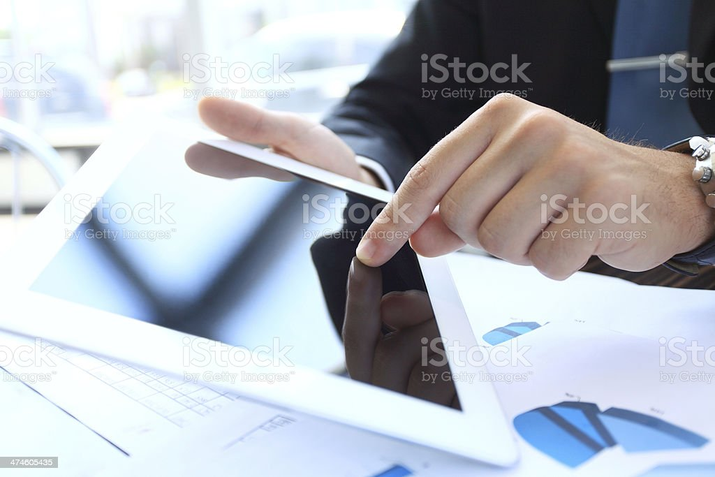 Hand touching on modern digital tablet pc at the workplace royalty-free stock photo
