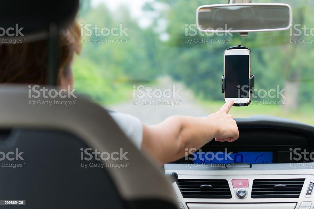 Hand touching screen on smart phone stock photo