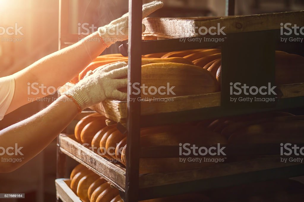 Hand touching shelves with bread. stock photo