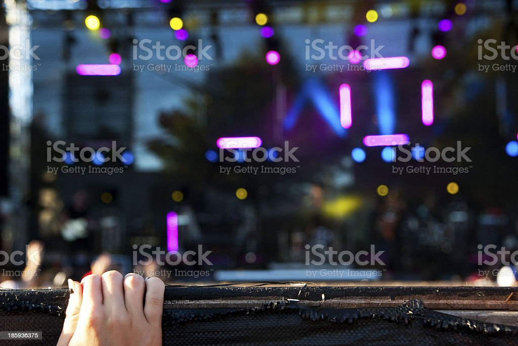 Hand touching stage at concert stock photo