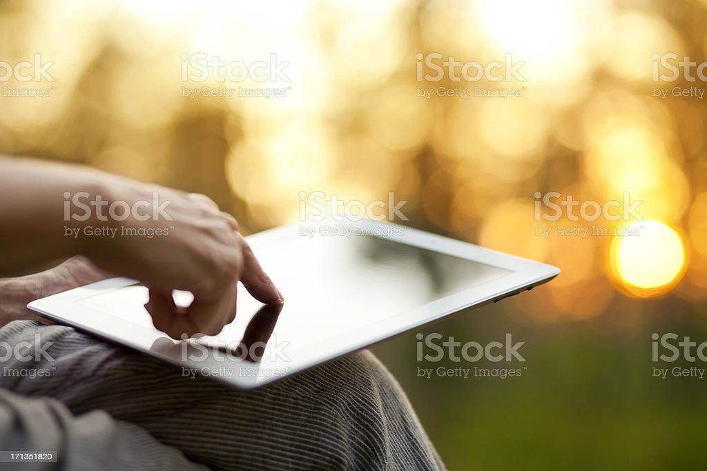 Hand touching tablet PC screen royalty-free stock photo