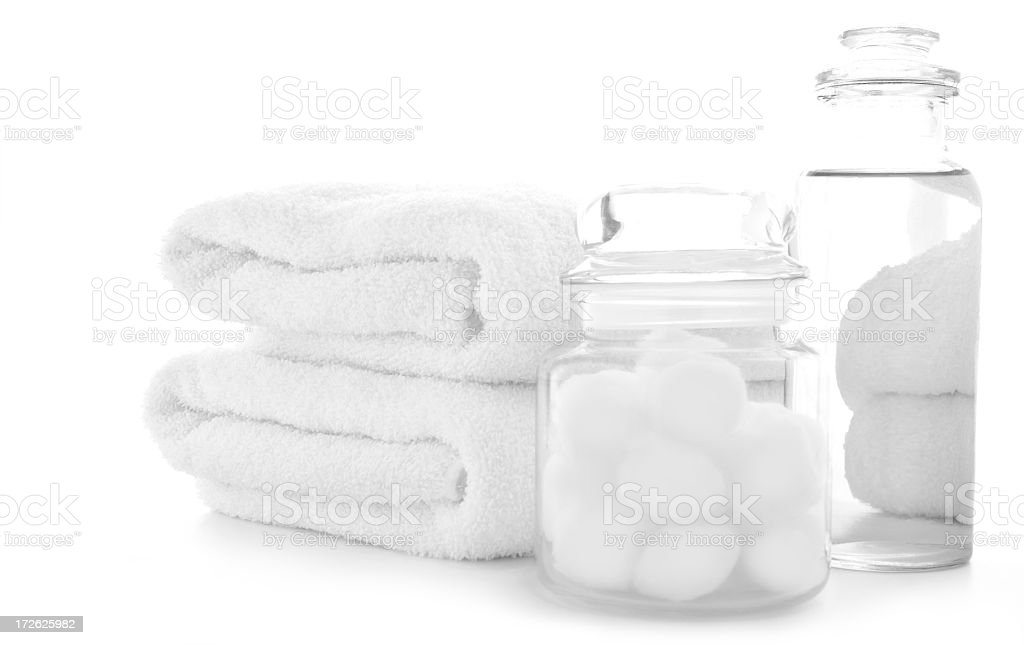 Hand Towels, Cotton Balls and Astringent Sitting on a Table royalty-free stock photo