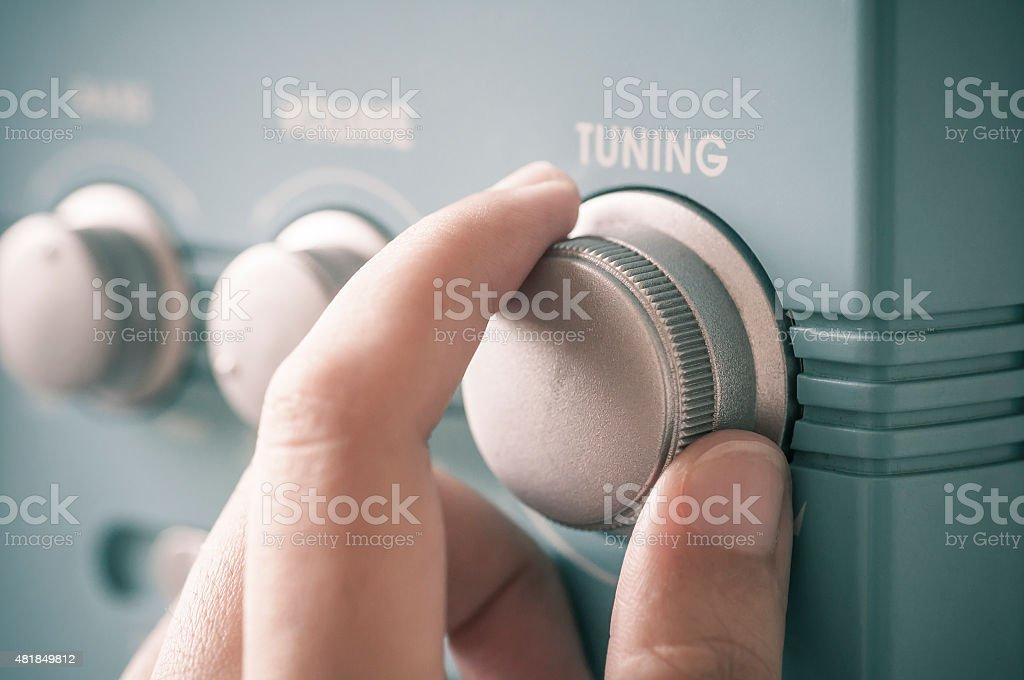Hand tuning fm radio stock photo