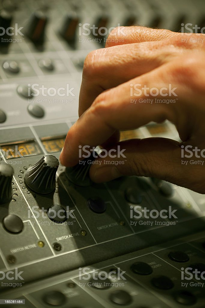 Hand turning a knob in professional mixer stock photo