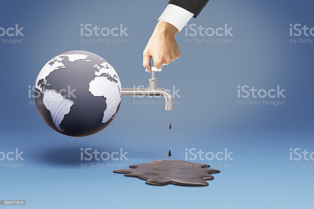 Hand turning on oil tap stock photo