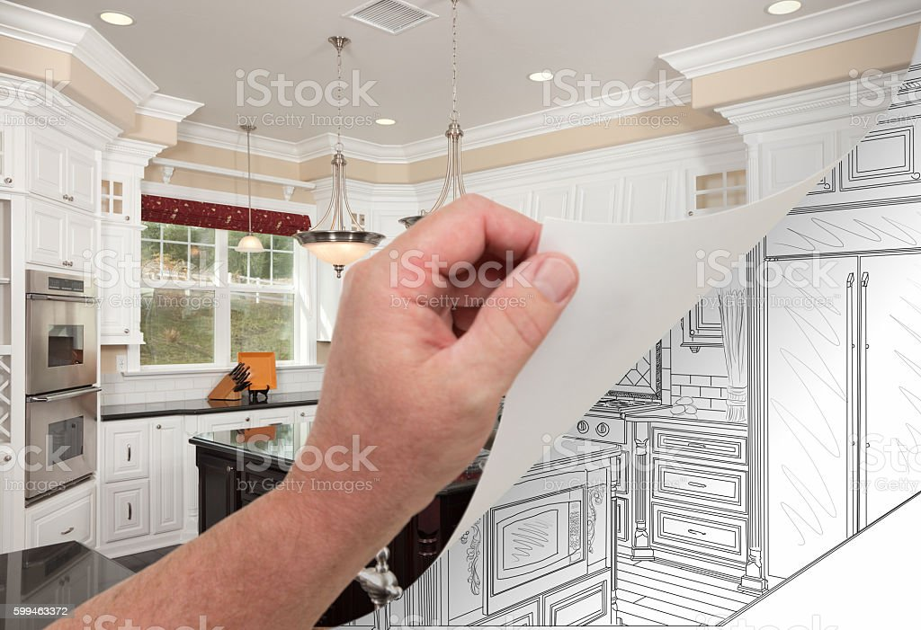 Hand Turning Page of Custom Kitchen Photograph to Drawing stock photo