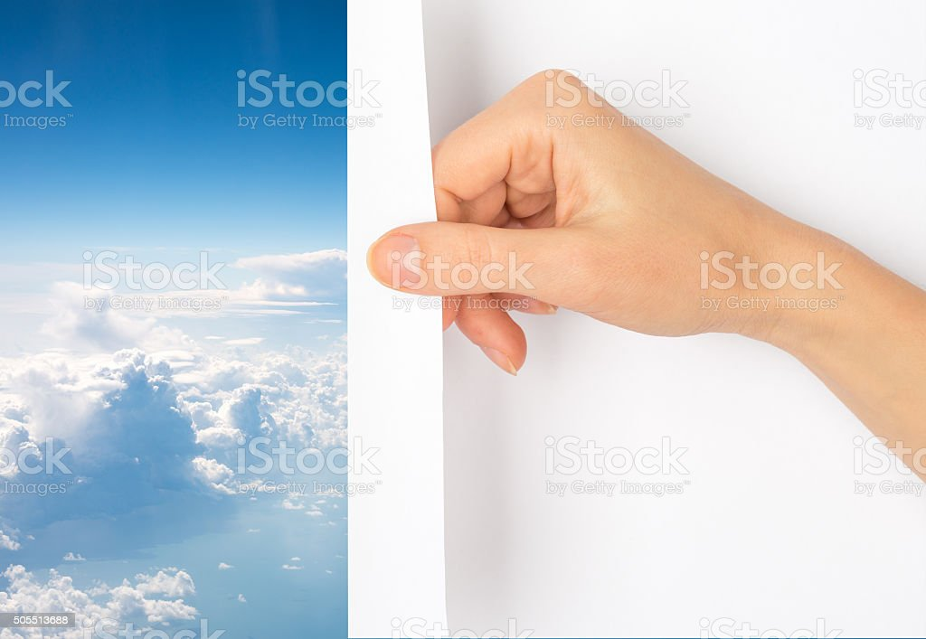 Hand turning page stock photo