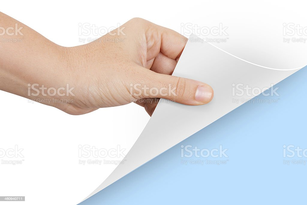 Hand Turning Page to Blue stock photo