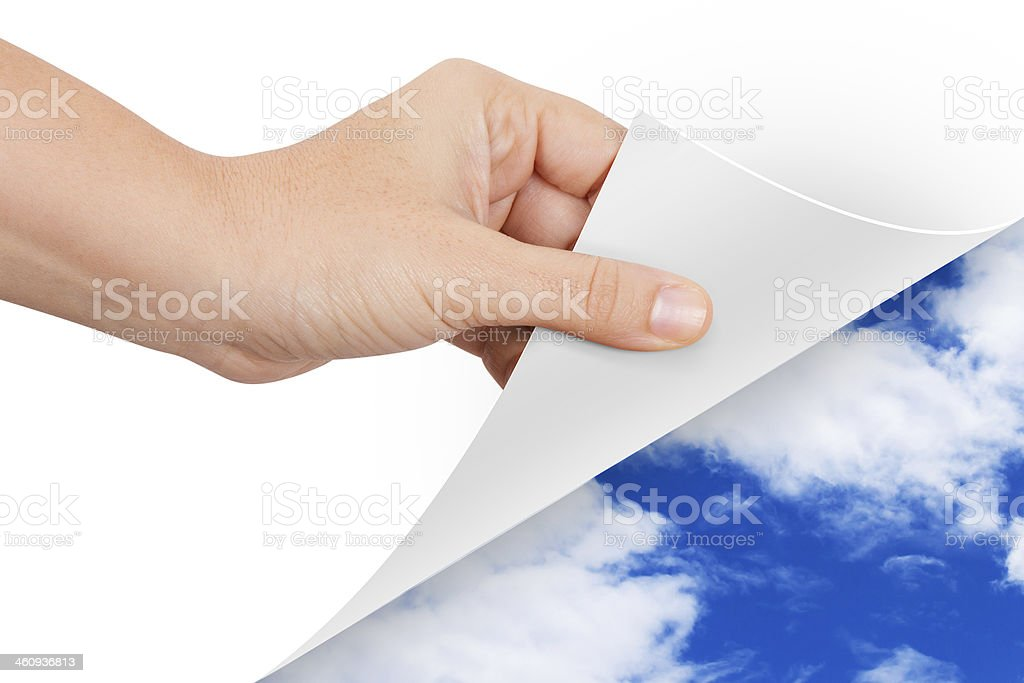 Hand Turning Page to Weather stock photo