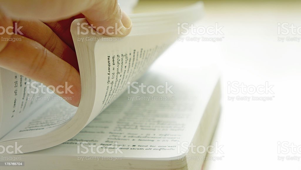Hand turning pages stock photo