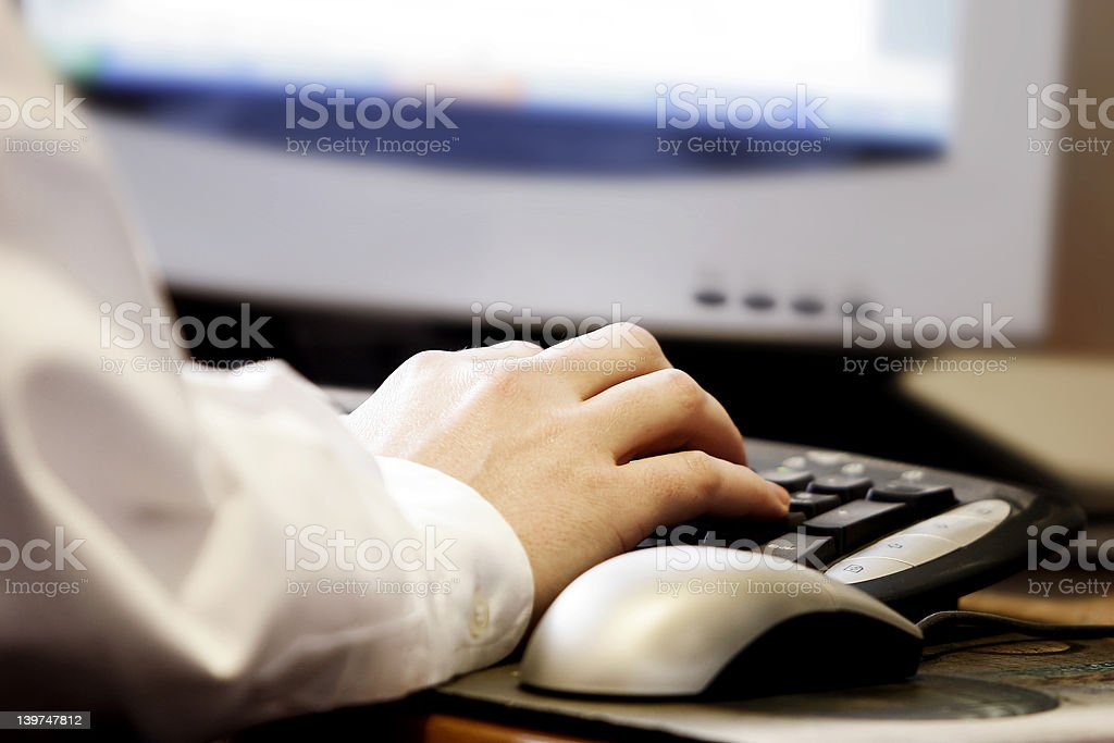 Hand Typing at a Computer royalty-free stock photo