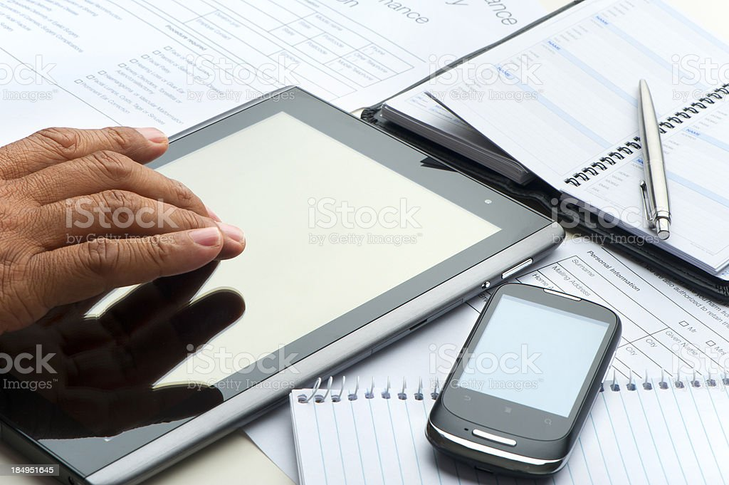 Hand typing on a digital tablet royalty-free stock photo