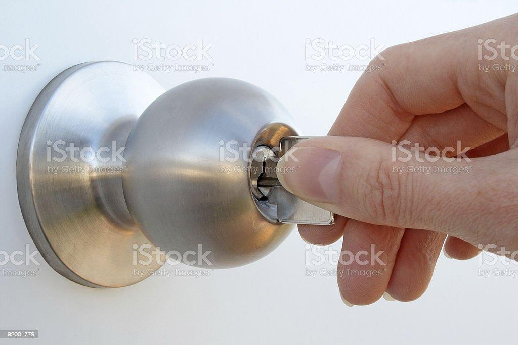 Hand unlocking the door stock photo
