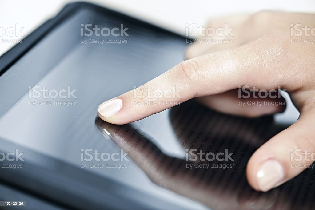 A hand using a tablet computer  royalty-free stock photo