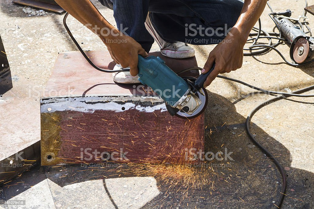 Hand using grinding machine and sparks royalty-free stock photo