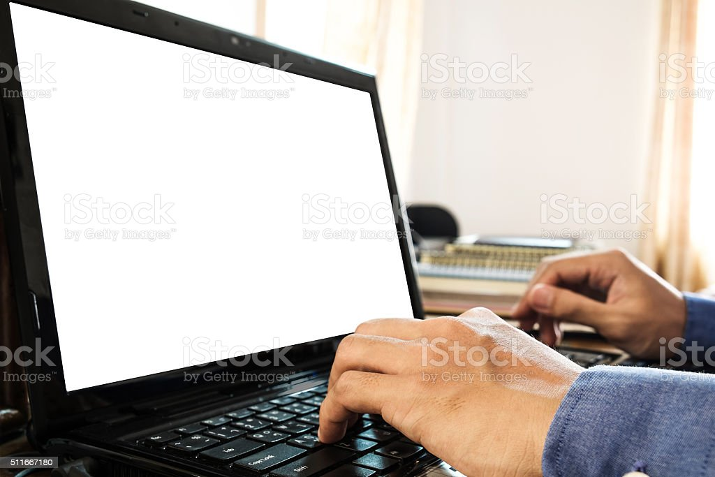 Hand using laptop at home office, with copyspace on screen stock photo