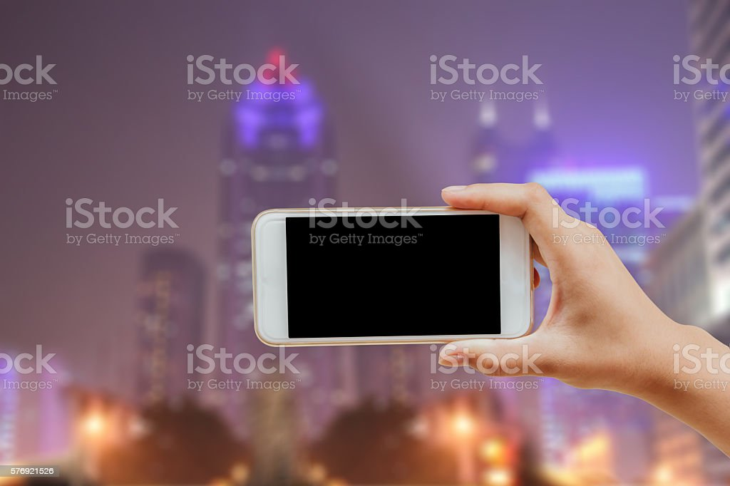 hand using mobile phone stock photo
