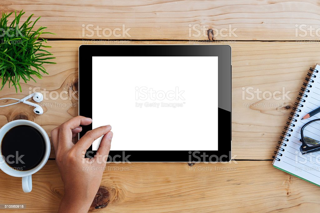 hand using mockup tablet on wood desk white display stock photo