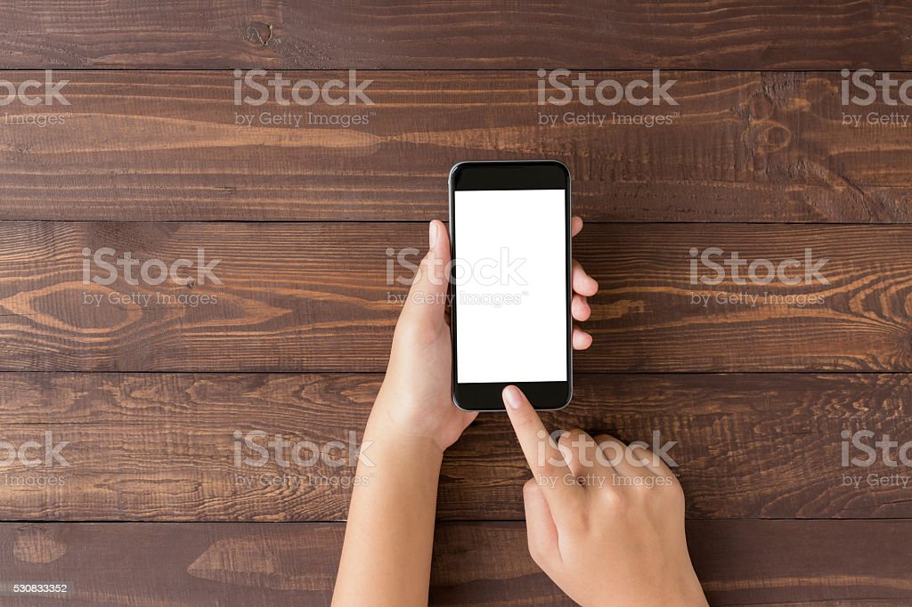 hand using phone blank screen on top view angle stock photo