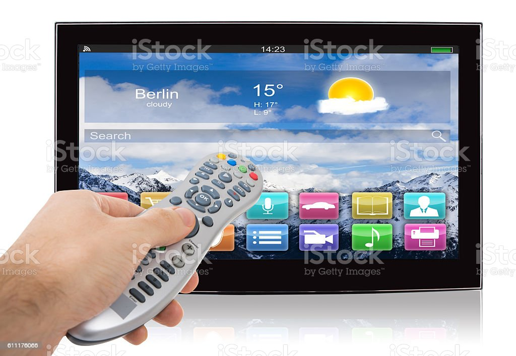 Hand Using Remote Control Of Smart Flat Screen Television stock photo
