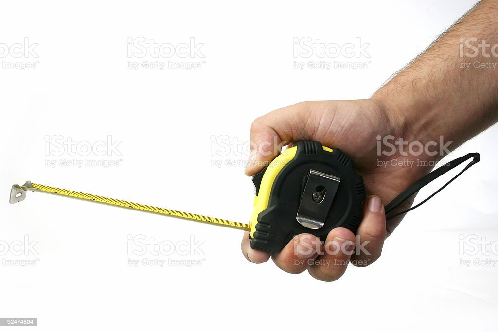 Hand using tape measure royalty-free stock photo