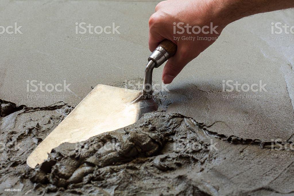 hand using trowel stock photo