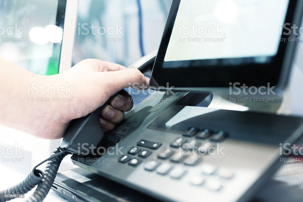 hand using videophone on exhibition. stock photo