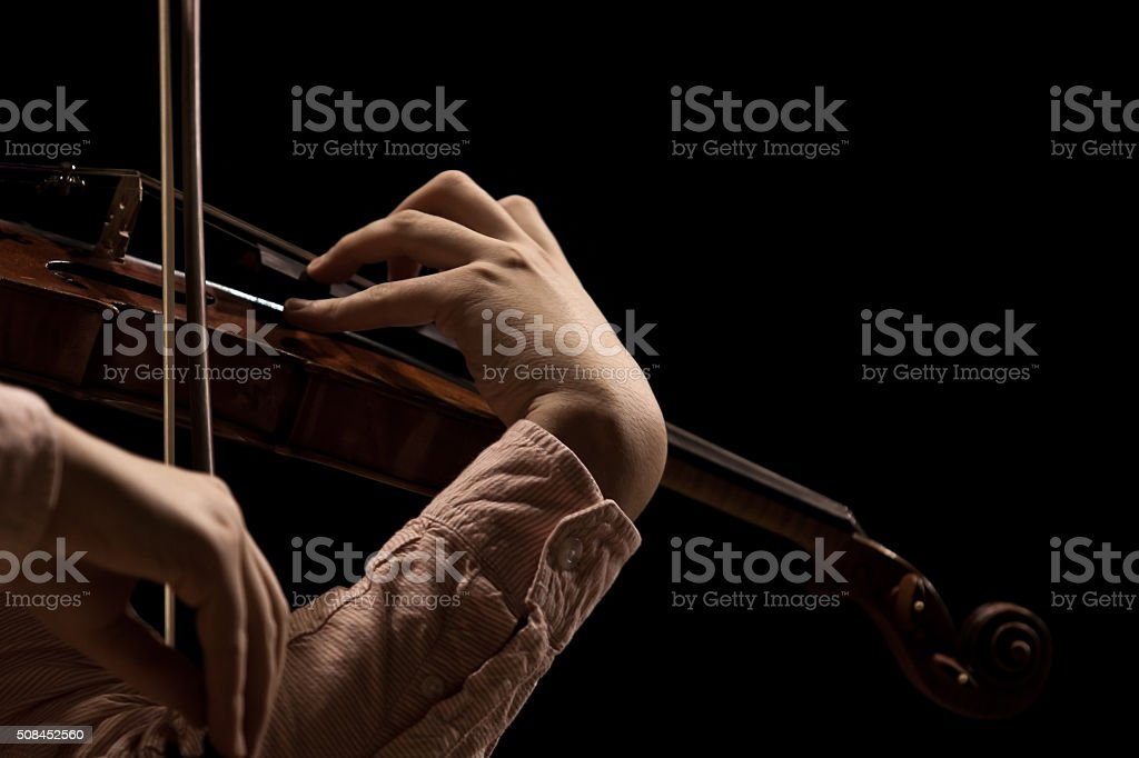 Hand violinist closeup stock photo