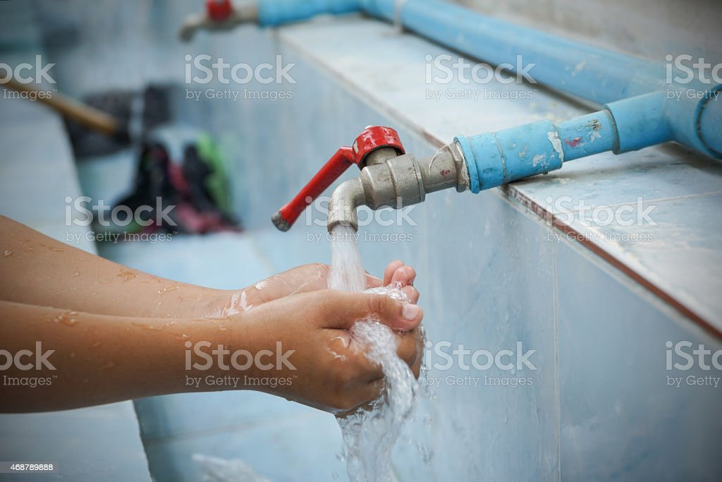 Hand Wash from faucet stock photo
