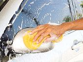 Hand washing car.