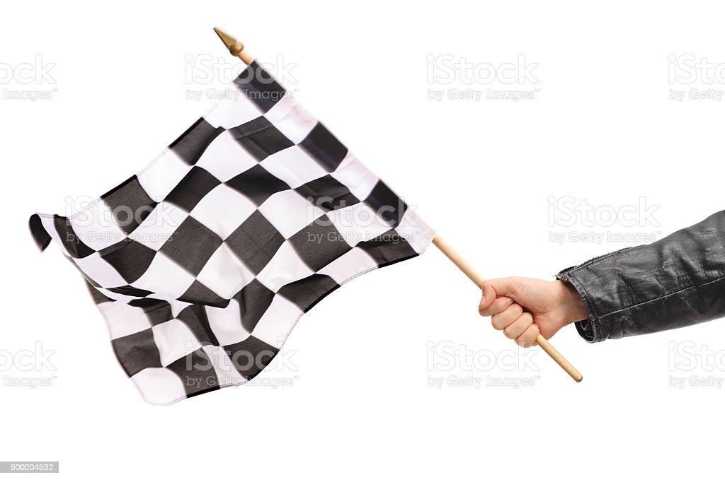 Hand waving a checkered race flag stock photo