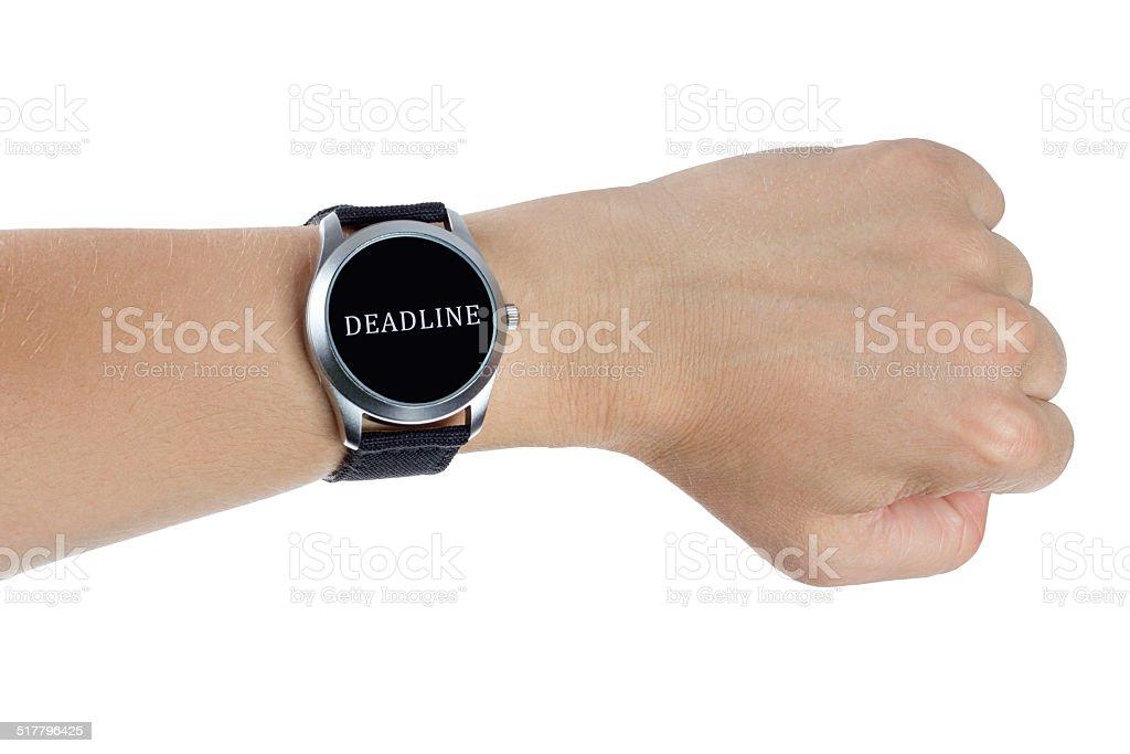 Hand wearing a black wrist watch. Deadline concept stock photo